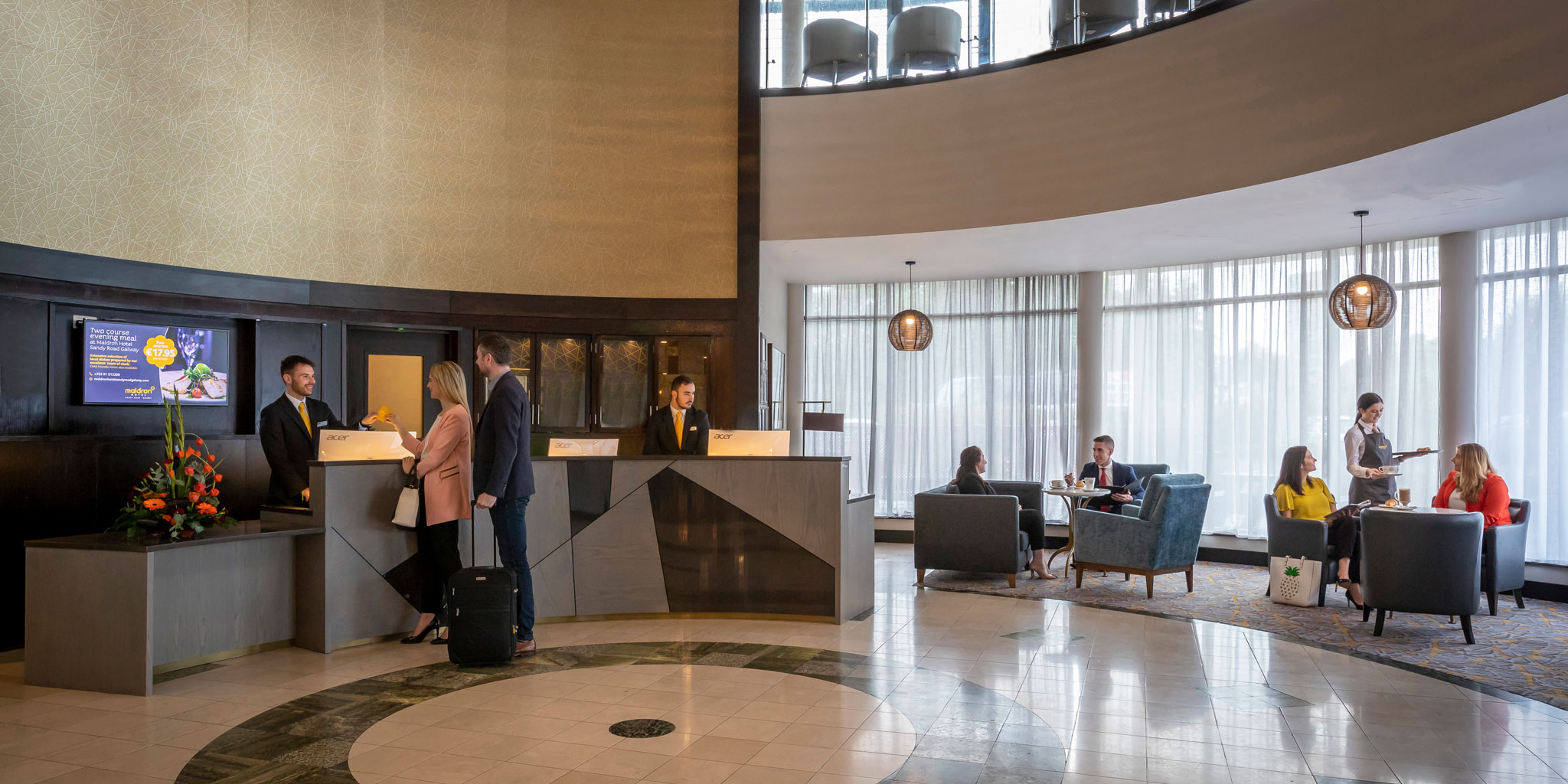 People checking in and relaxing in hotel reception at Maldron Sandy Road