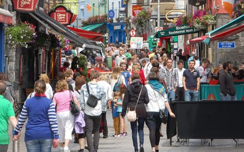 People enjoying a stroll in Quay Street Galway